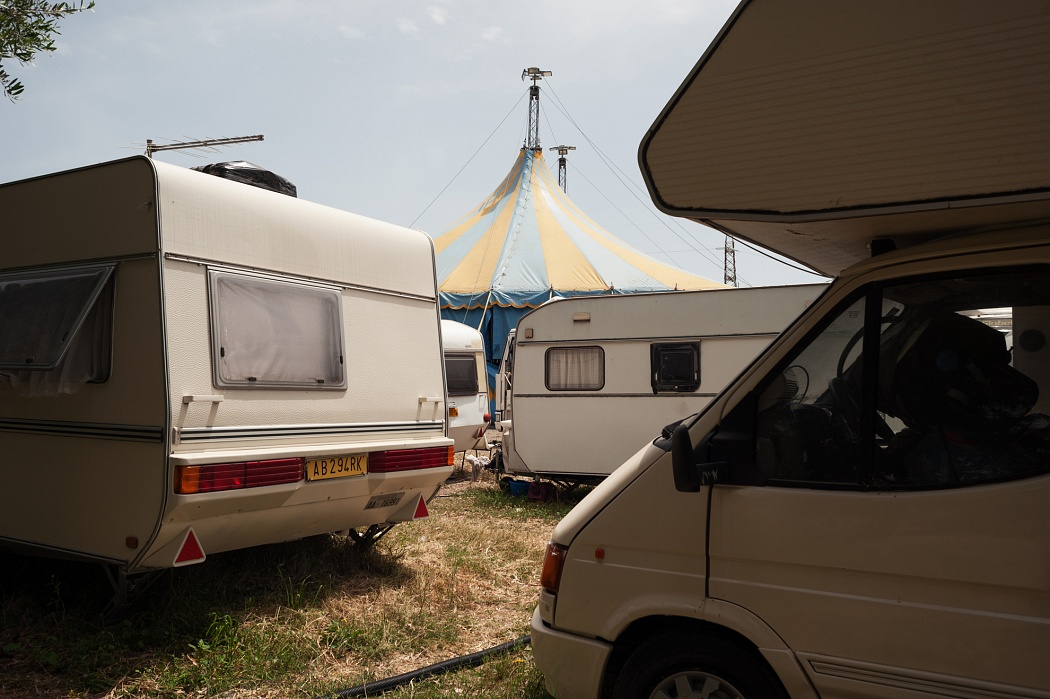 The caravan is placed around a little circus tent.